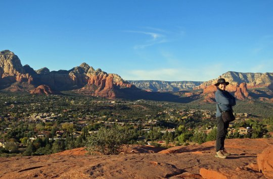 Peggy stands on top of the vortex located near the Sedona Airport. Sedona lies below, hemmed in by Red Rocks.