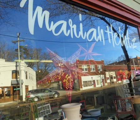 Chattanooga's Brainerd Road is reflected in the window of Marian's studio.