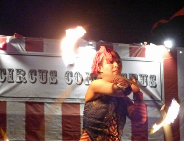 It doesn't matter which street you walk down at Burning man, you can always expect to find sideshows that capture you attention. This woman displays her fire art. (Photo by Don Green, a member of our 'tribe.')