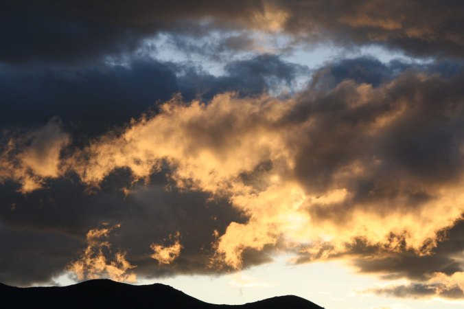 Clouds are illuminated by a setting sun on the Black Rock Desert.
