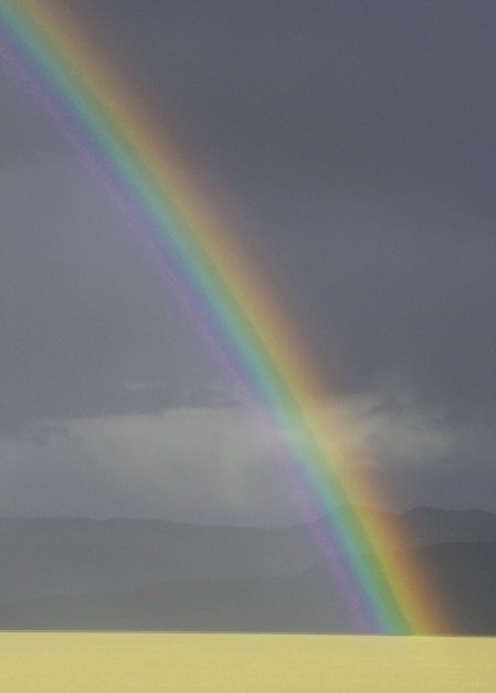 We were coming into Burning Man when we hit a rainstorm and saw this Rainbow.