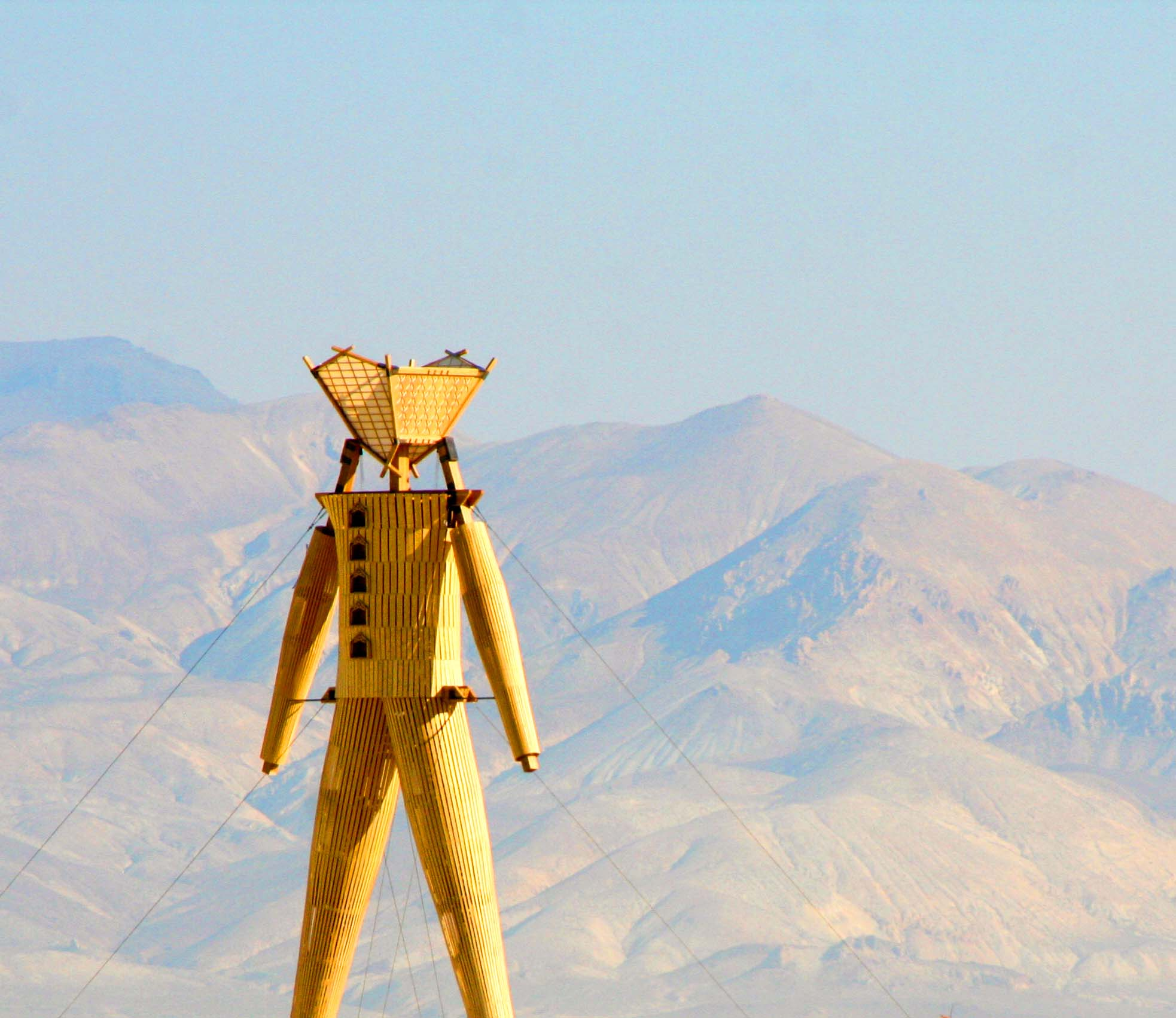 Mountains of the Black rock Desert stand behind the Man at Burning Man.