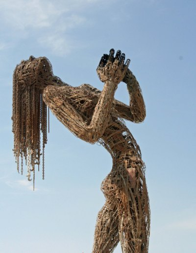 Nude sculpture celebrates the break of day at Burning Man.
