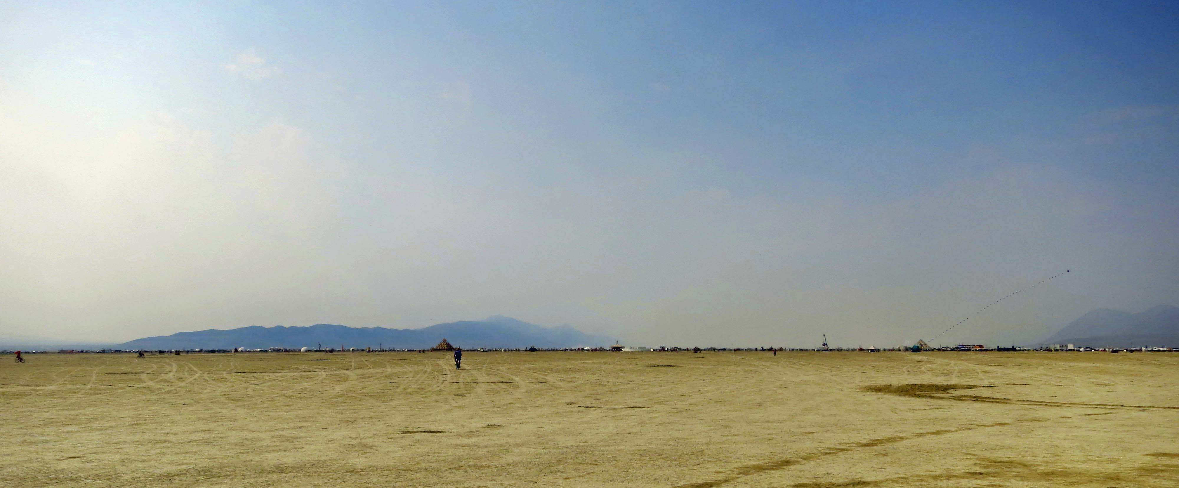 The Playa at Burning Man is made up of a lakebed that was once buried under Lake Lahotan. Black Rock City stretches across the horizon.