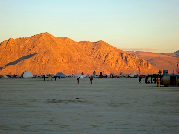 Sunset reflected on a mountain at Burning Man in the Black Rock Desert.