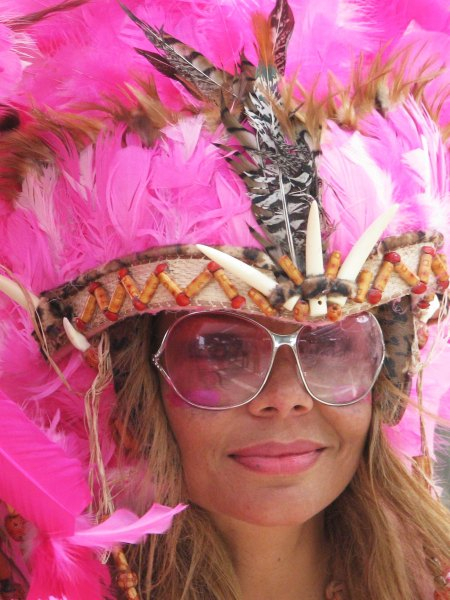 This pink feather headdress, pink glasses, and pink lipstick were quite dramatic.