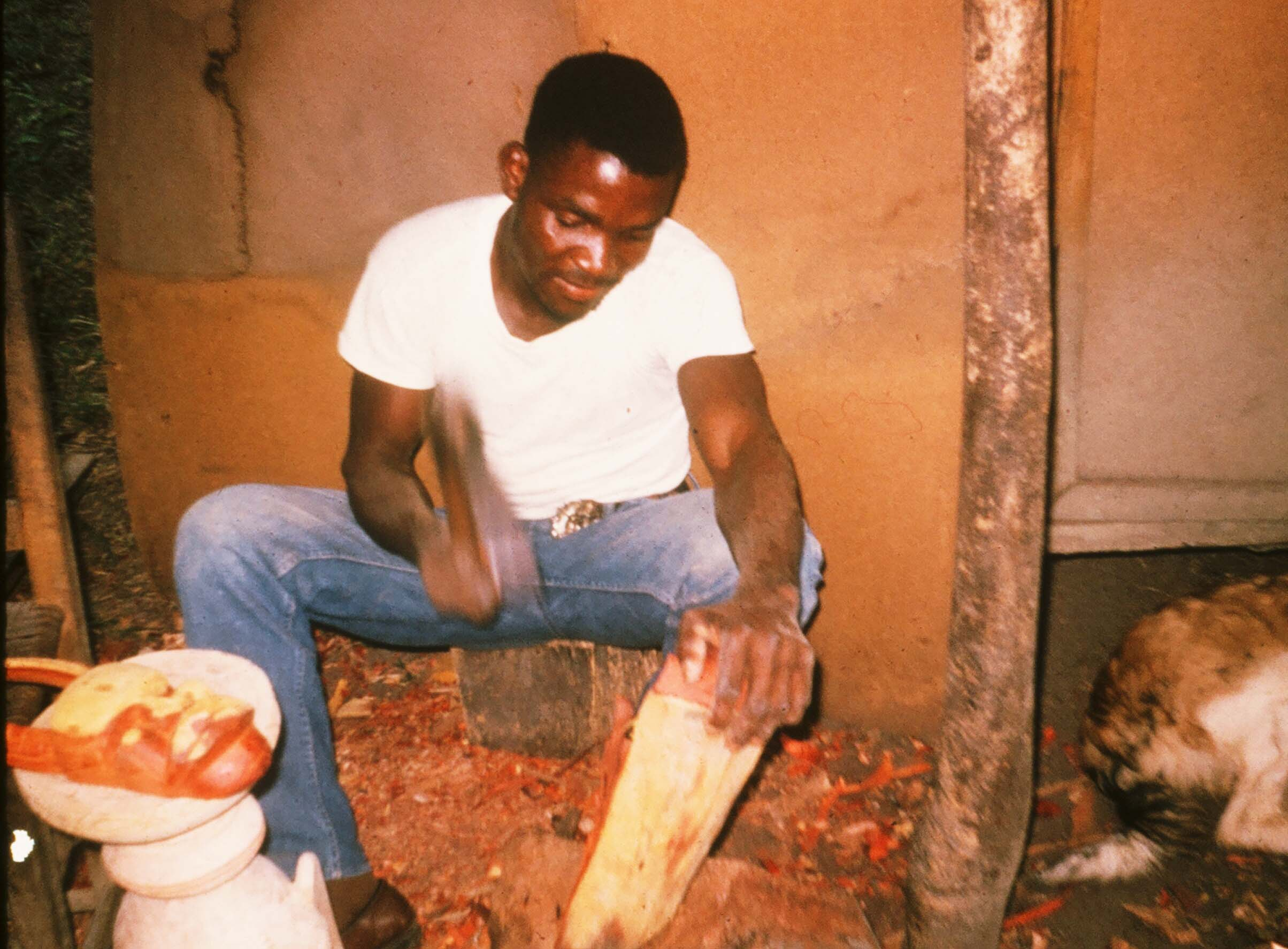 """The """"Bush Devil"""" featured on the cover of my book was created by Freddy the Carver shown here. Freddy was a leper who lived in a leper colony in Ganta, Liberia circa 1965."""