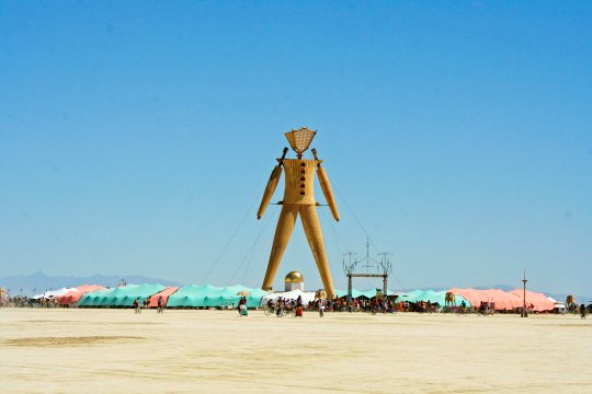 The Man at Burning Man dominates the Playa and serves as a landmark for lost Burners.