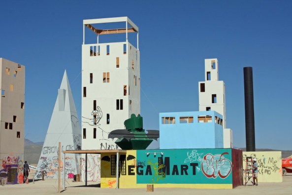 Small cities destined to be burned, such as this Mega Mart are occasionally built out on the Playa at Burning Man.
