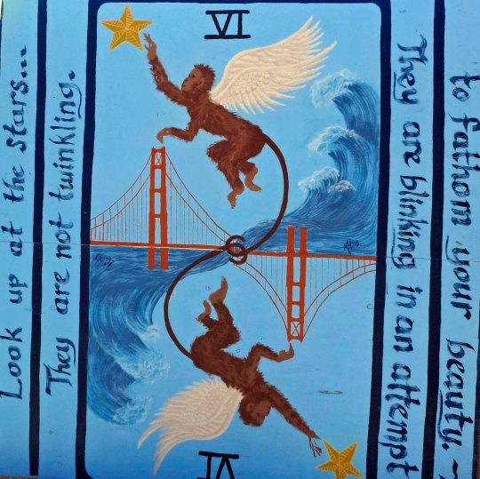 Monkey mural and Golden Gate Bridge with message.