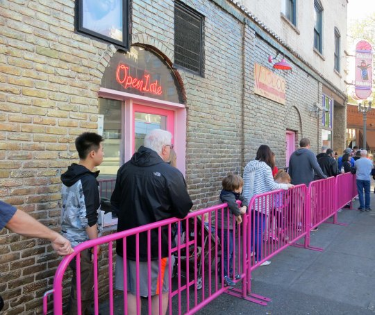The ever present line of people waiting to get into the Voodoo Doughnut shop for their daily dose of sugar.