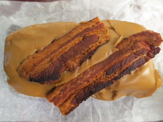 I am convinced this is a new definition of sin— a bacon maple bar from Voodoo Donut shop in Portland. The donut shop was located next to the Press publish Conference I was attending in Portland, Oregon.