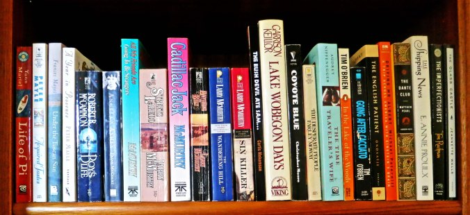 Another shelf of our books. BTW, I highly recommend the book just to the left of Lake Woebegone Days. (grin)