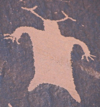 Man With Antlers practices flying leap.