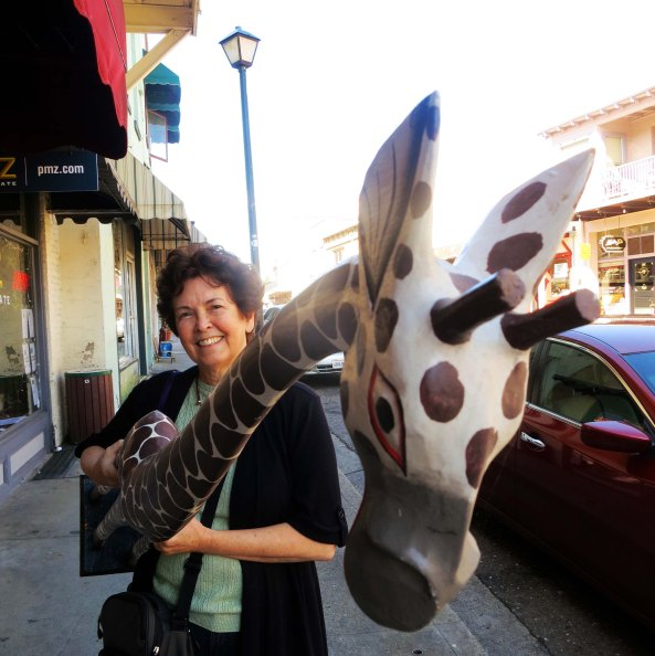 Peggy fell in love with this balsa wood giraffe we found in Jackson, California. So the giraffe came home with us. Little did we think it would have a taste for petunias.