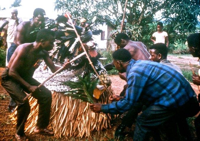 The Grebo men carefully tended the Bush Devil.