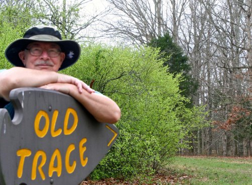 I wondered if Peggy had some type of message in mind when she asked me to pose for this photo. The sign is pointing toward portions of the historical Trace that are still found along the Parkway.