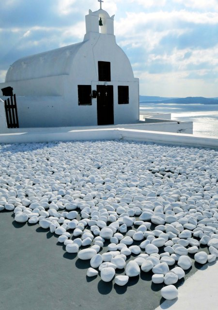 Think of the imagination that went into the decision to put white rocks in front of this white church.