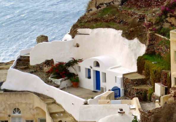 Homes are actually built into the volcanic cliff as this photo illustrates. The added insulation means the houses are cool in the summer and warm in the winter.