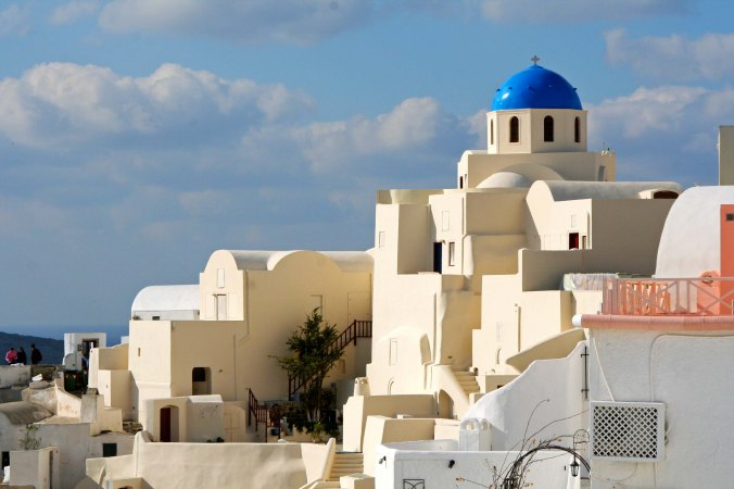 It is a combination of the blue domes, unique architecture, magnificent setting and Mediterranean light that make the many churches in Oia so outstanding. (Photo by Peggy Mekemson.)