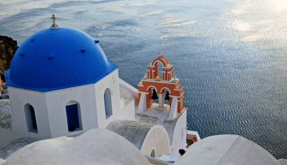 The Anastasis Church in Oia provides a striking view of the Aegean Sea.