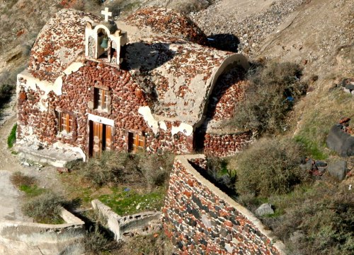 This looked like a very old church to me. Notice how it is built into the cliff. (Photo by Peggy Mekemson.)