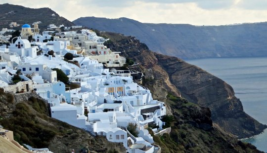 The town of Oia overlooks the caldera of what was once a volcano and is now filled with the Aegean Sea.