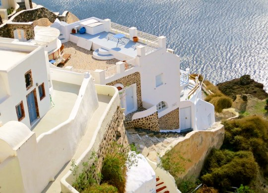 Perched on the remaining wall of an ancient volcano, the Greek town of Oia overlooks the Aegean Sea.