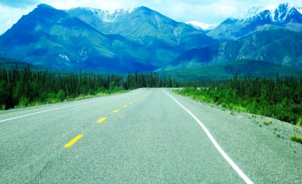 Sights along the the Alaska Highway include towering mountains...