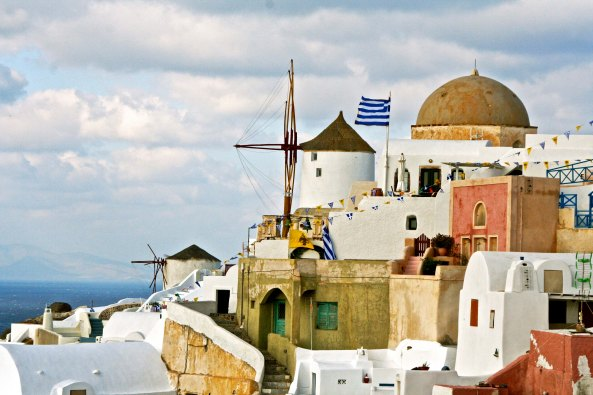 Peggy caught this photo of an old Santorini windmill that I found quite stunning. We found similar windmills won other Greek islands.