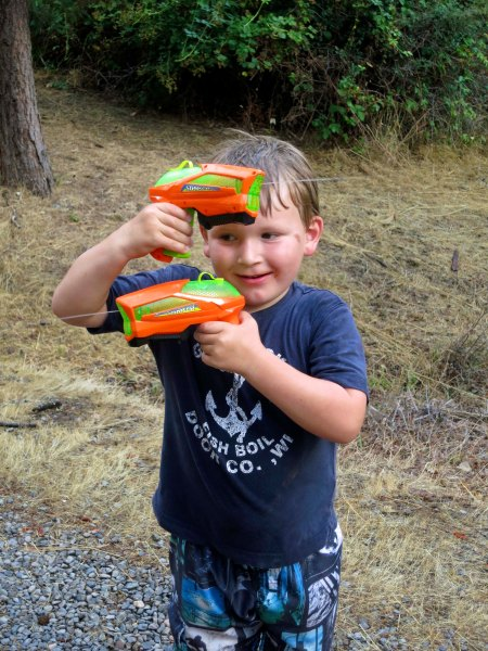 Chris proves to me that his water pistols are functioning and ready for action.