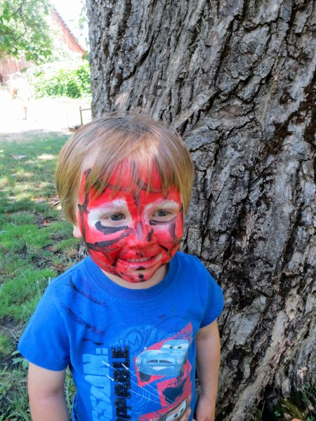 Cooper proudly displays his Spider face paint he picked up when we visited the Civil War reenactment camp. The boys were quite excited to see cannons fired.