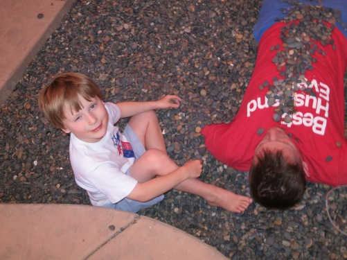As you might imagine, the boys found burying dad in rocks, as Connor is doing here, to be quite amusing.