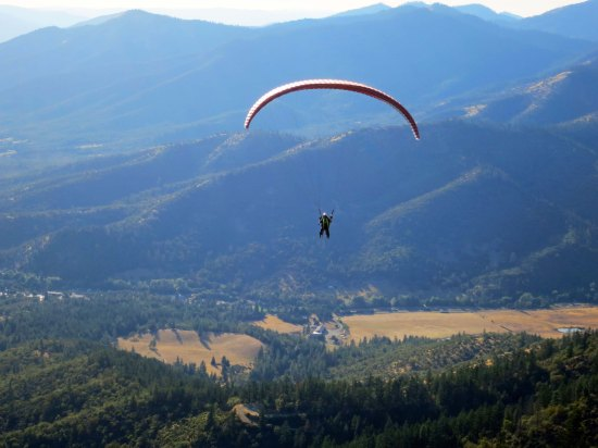 Peggy paragliding over the Applegate Valley.