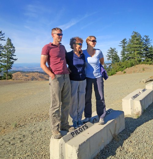 Tony, Peggy and Tasha stand on the pilots block and prepare for their assisted paragliding adventure.