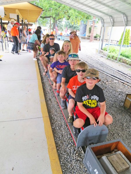 Everyone climbed on the train at the Medford Railroad Park.