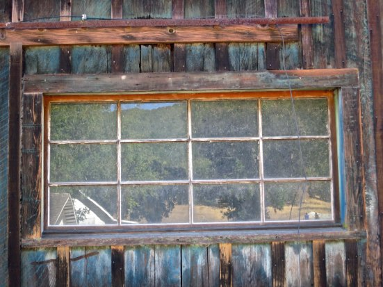 Reflections caught in one the barn's windows.