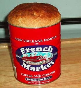 The Diggers would distribute thousands of loaves of bread, baked in a coffee can like this.