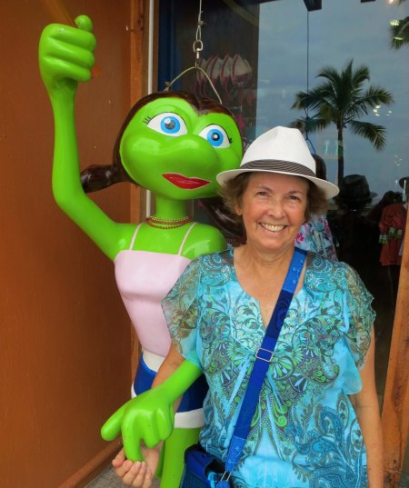 Peggy has her photo taken with Senorita Frog on the landside of the walkway.