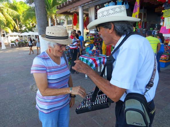Our friend Leslie made the mistake of showing interest in a hawker's bracelets on the lower Malecon and ended up buying four. He was one happy salesman.