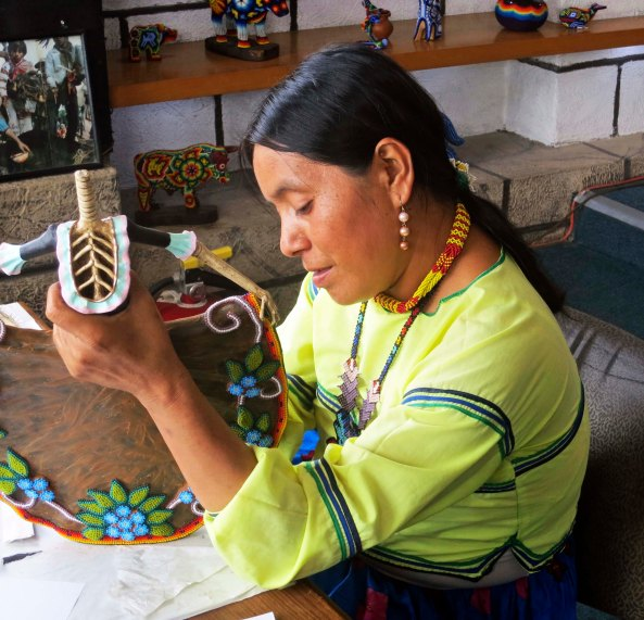 A Huichol artist worked on creating a Catrina in one of the shops we visited.