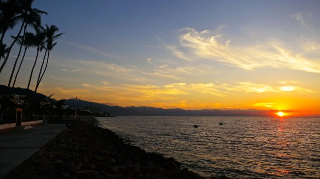 Looking south from the northern section of the Malecon as the sun sets over Puerto Vallarta and Banderas Bay.