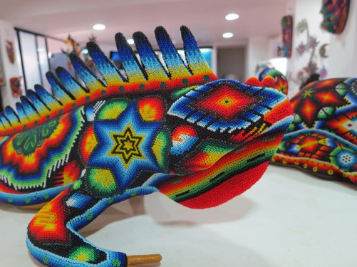 I haven't heard of iguanas being a choice for shape shifting. Maybe that's why this Huichol piece looks sad.