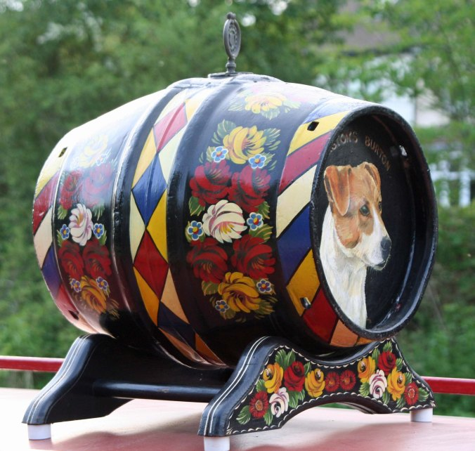 We spotted this water cask with its realistic portrayal of a dog on top of a narrowboat.