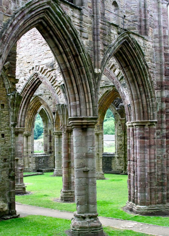 Graceful columns found when stepping inside the ruins of Tintern Abbey.