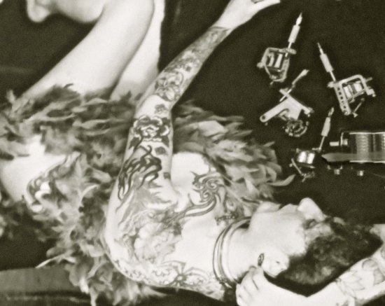 The tattoo machines on the right are capable of producing sophisticated body art.