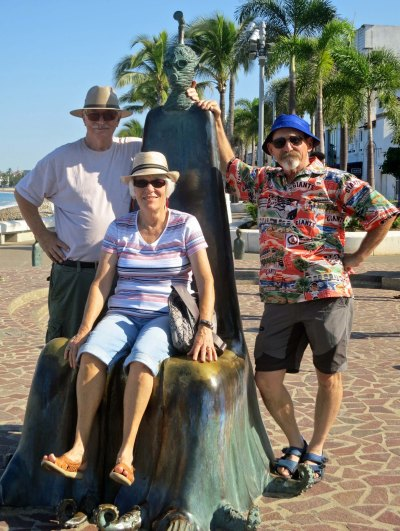 Much of the art on the Malecon encourages interaction, much like Burning Man art. Here I am with our friends Ken and Leslie Lake.