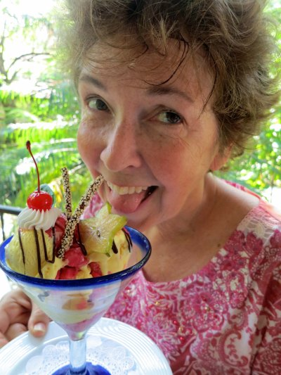 Numerous good restaurants in Puerto Vallarta always tempt us. Peggy chomps down on a tropical creation.