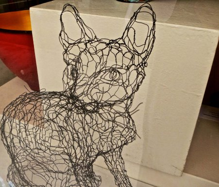 Shops feature everything from crafts to very good art. I found this cat in a shop next to the book store and was amused/impressed by the creative use of chicken wire.