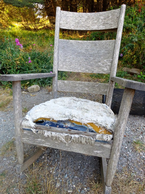 I hound this old rocking chair sitting alone Highway one. All it needed was an old codger to sit in it.
